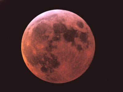 The totally eclipsed moon shines redly